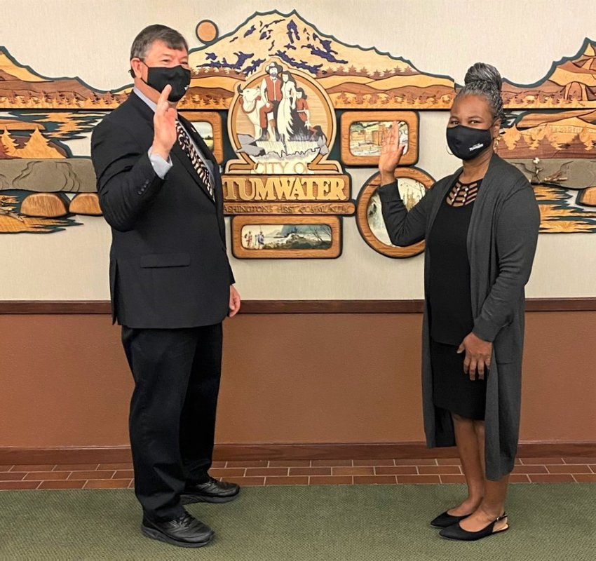 Tumwater Mayor Pete Kmet administers the oath of office to incoming Councilperson Angela Jefferson on Monday, March 22, 2021. Photo courtesy of City of Tumwater.