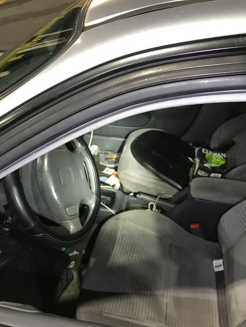 A partial six-pack of beer is seen on the front seat of a car allegedly driven by Salvador Rivera on May 6, 2021.