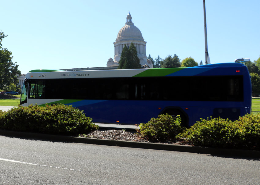 One of Intercity Transit's newer full-size busses passes in the east side of the Legislative Building on the Washington State Capitol Campus on Route 13.