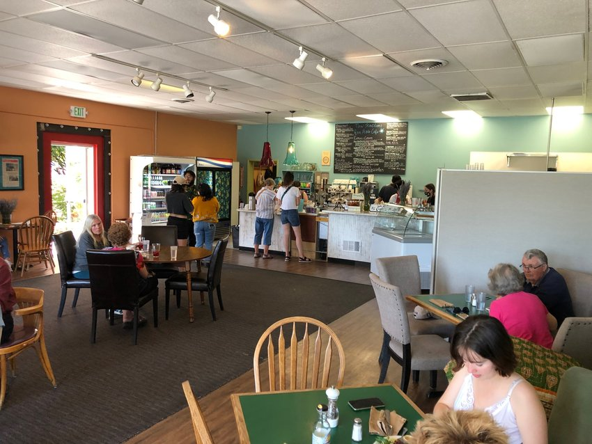 With a new paint job and door to the new covered patio, New Traditions Cafe is much brighter than before its 2021remodel.