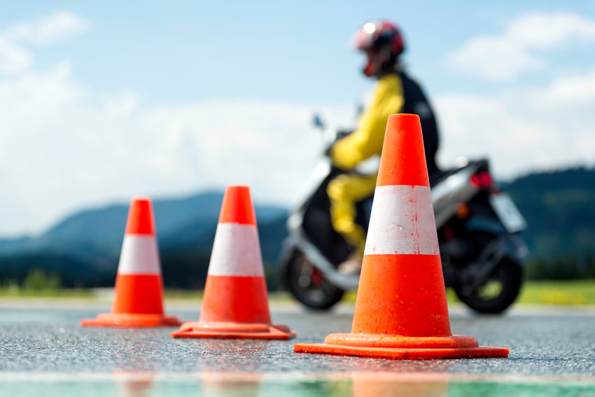 Specialized motorcycle safety training schools let inexperienced drivers crash into harmless traffic cones instead of actual traffic obstacles.