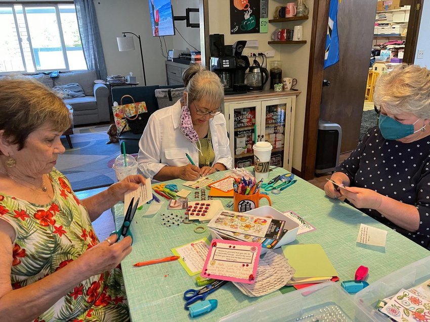 The ladies from the General Federation of Woman's Clubs' Capital Woman's Club volunteered to help the Lacey~Oly Crafty Sewers to create inspirational messages which will go with each purse. Pictured, l-r: Dorothy Crowder, Nardine Sandberg and Karen Smith.
