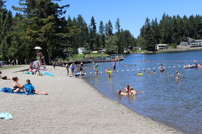 A view of the public swimming area at Long Lake in Lacey, in happier days when the water quality was better and lifeguards were on duty.