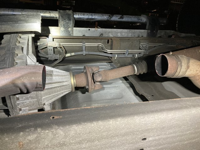 This is the undercarriage of the Ford Excursion truck from which a device appearing to be a catalytic converter was removed from between the pipes shown.
