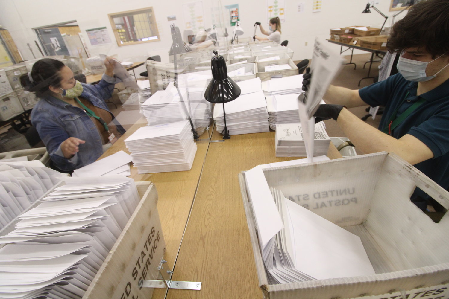 Back in June, election staff prepare voters' pamphlets at the Ballot Processing Center.