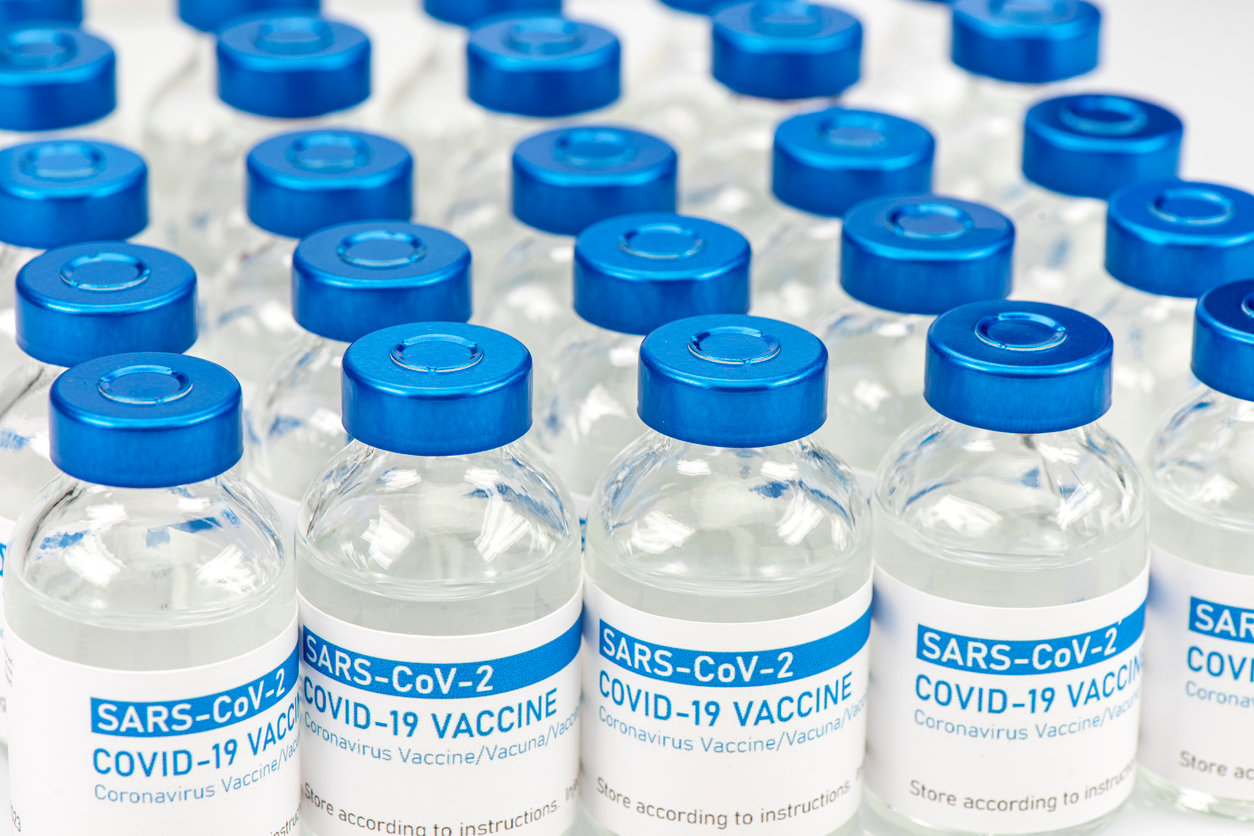 Closeup of a long row of vials with COVID-19 (coronavirus) vaccine.