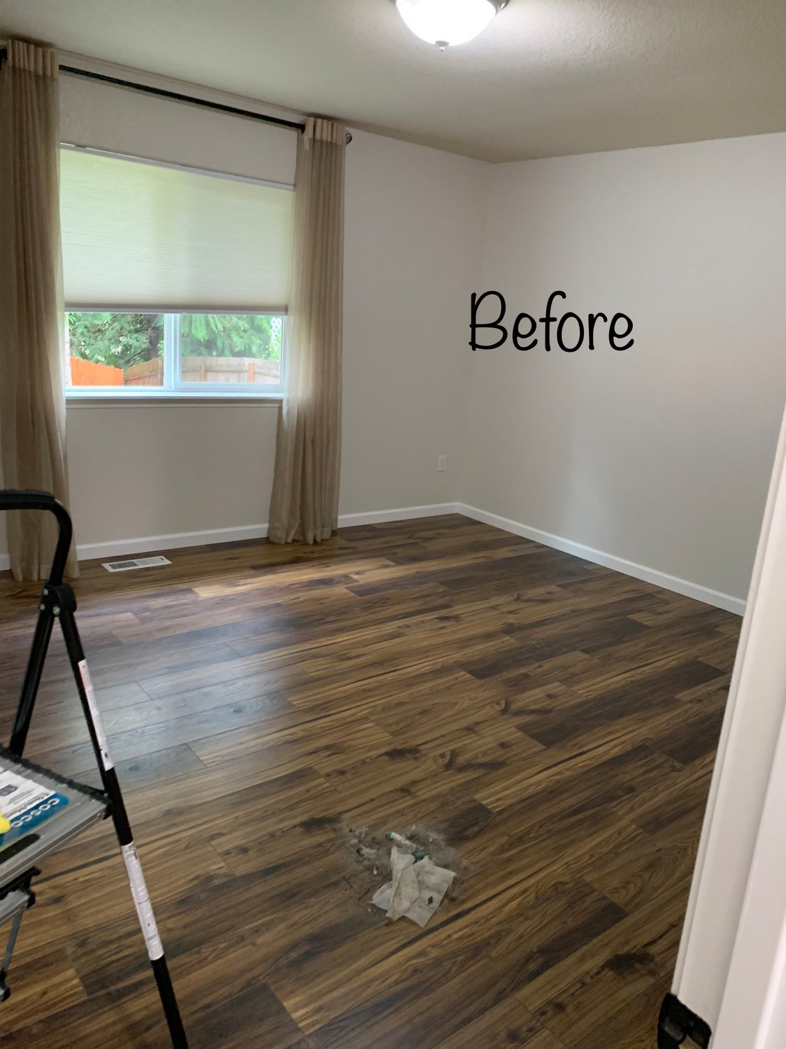 BEFORE: A bedroom with no furniture.