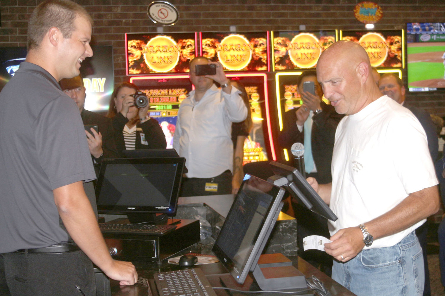 State Rep. Dave Jacoby, D-District 74, places a $20 bet on the Chicago Cubs at the Aug. 15 grand opening of the Elite Sportsbook at Riverside Casino and Golf Resort.