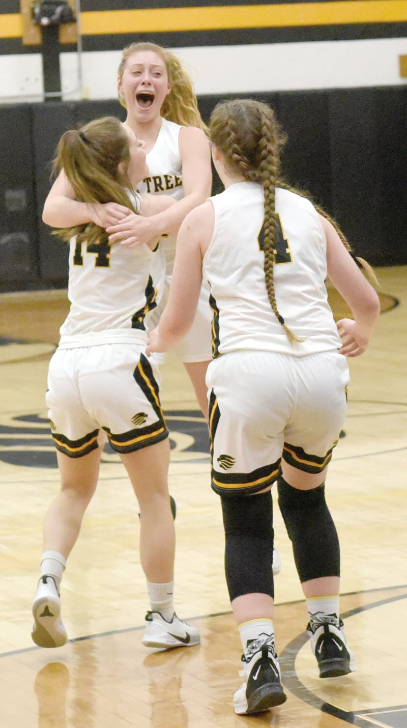 Holley Johnson hoists Maddie Jacque after Jacque's last-second shot provided the one-point margin of victory.