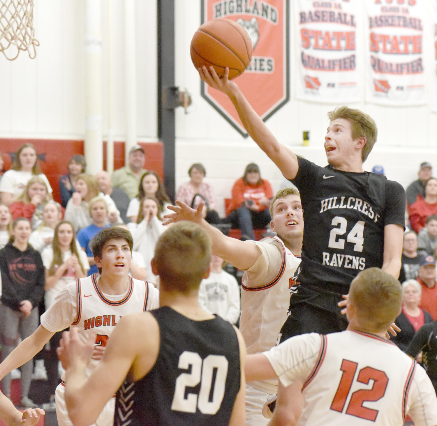 Hillcrest's Kobe Borntrager lays the ball up for a basket against Highland Feb. 20.