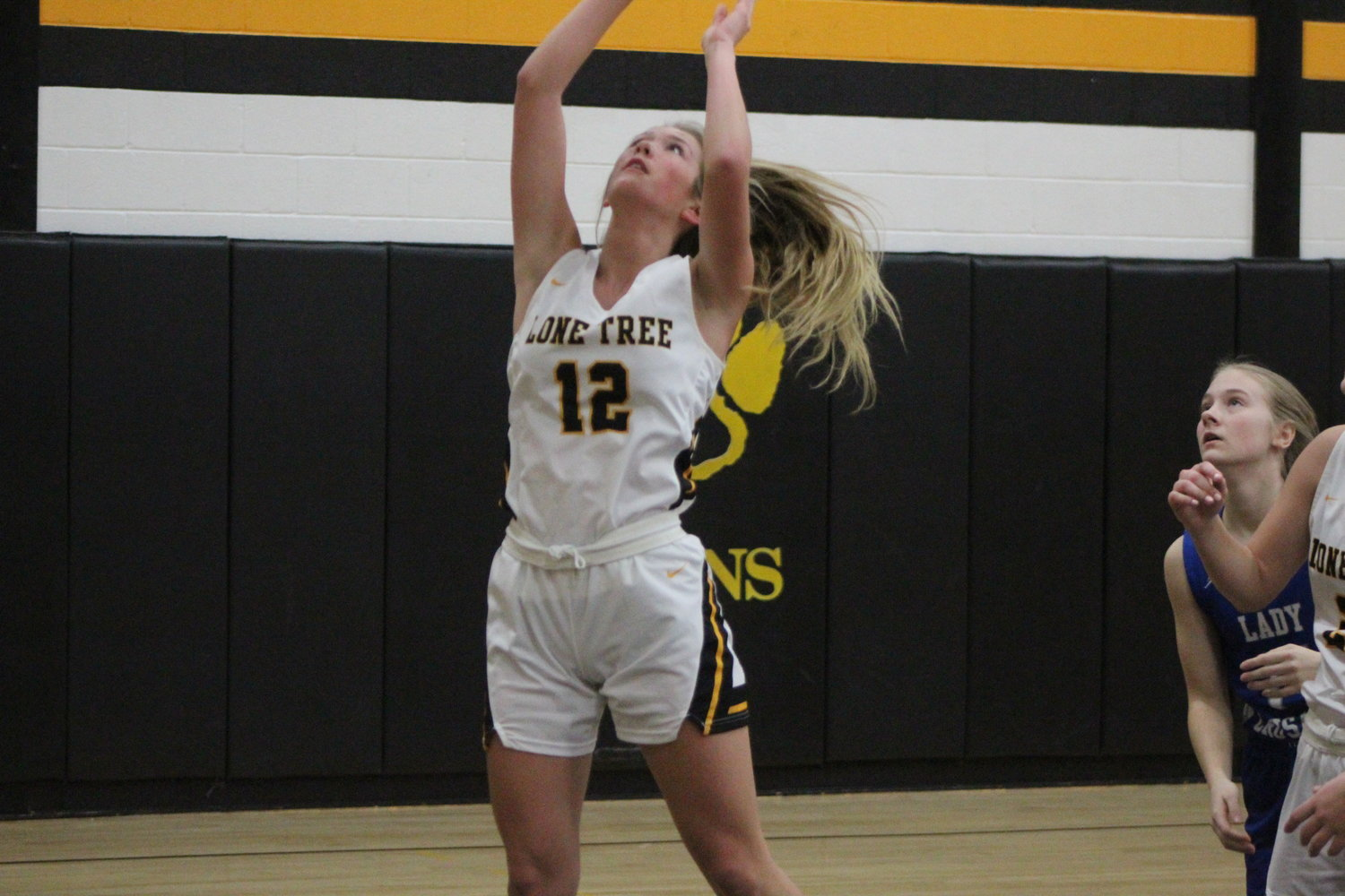 Josie Mullinnix goes up for a lay-up. Lone Tree topped the Crusaders in a hard-fought game, 59-52.