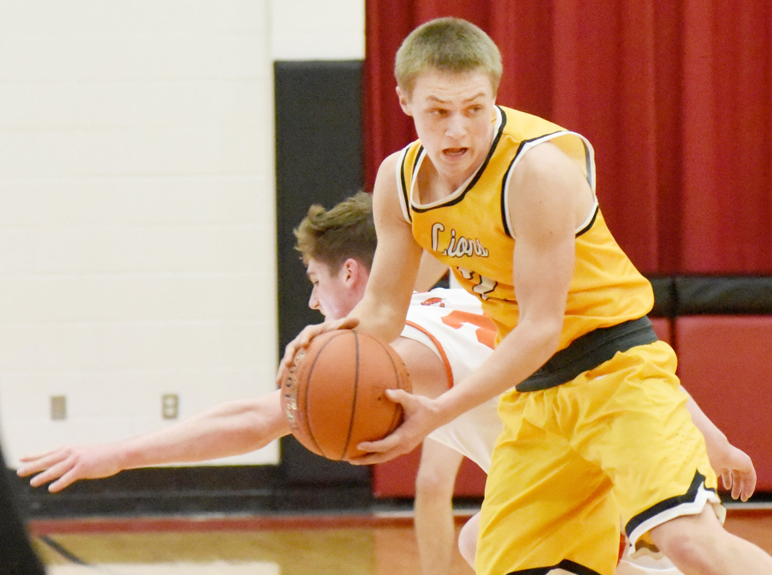 Tyler McCullough avoids pressure from Springville.