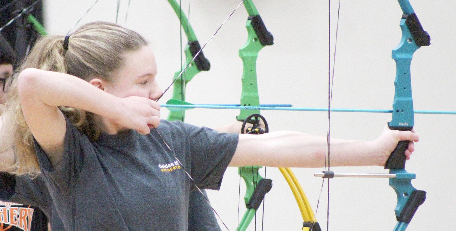 Mid-Prairie Golden Hawks Archery Club athlete Morgan Nafziger takes aim at the target during competition in Washington.