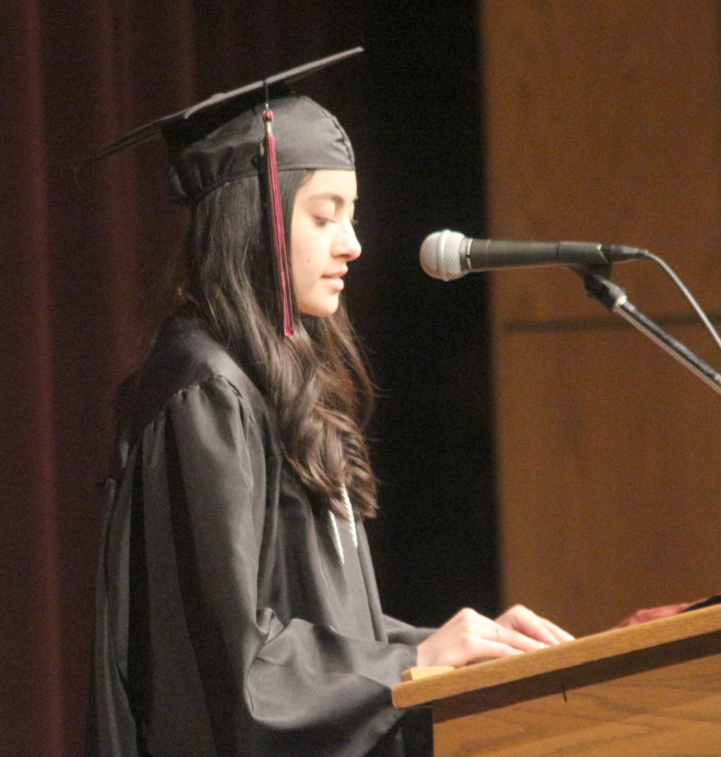 Yuli Montes de Oca speaks during the Hillcrest Academy commencement ceremony.