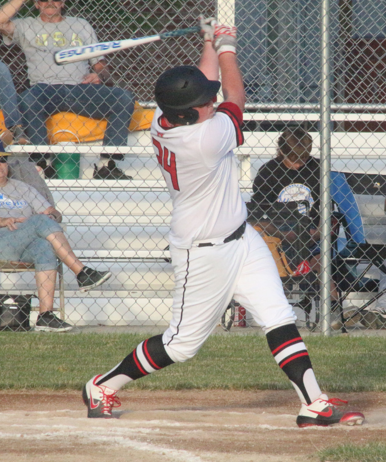 Highland's Chase Schultz takes a big swing on June 25.