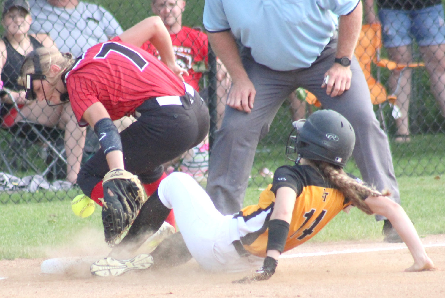 Lone Tree's Holley Johnson slides into third base safely in the first inning of the Lions' playoff loss to Lisbon on July 17.