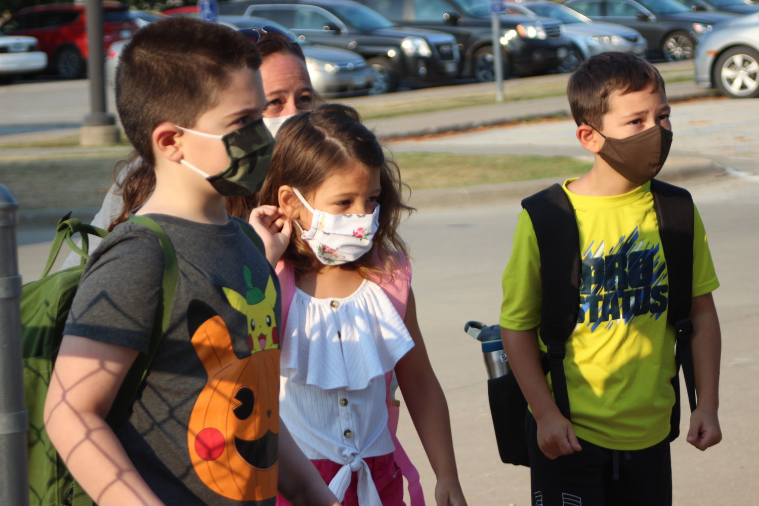 Bradley Kallaus, Saige Noel and Bailey Noel arrive for their first day of school at Highland Elementary.