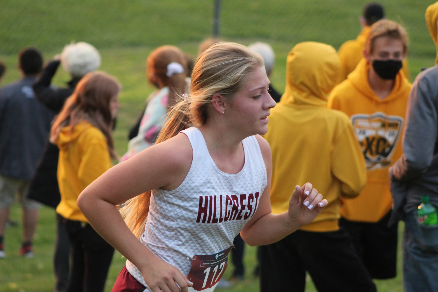Kennedy Roth of Hillcrest Academy heads up a hill and toward the finish line in Monday's girls varsity race.