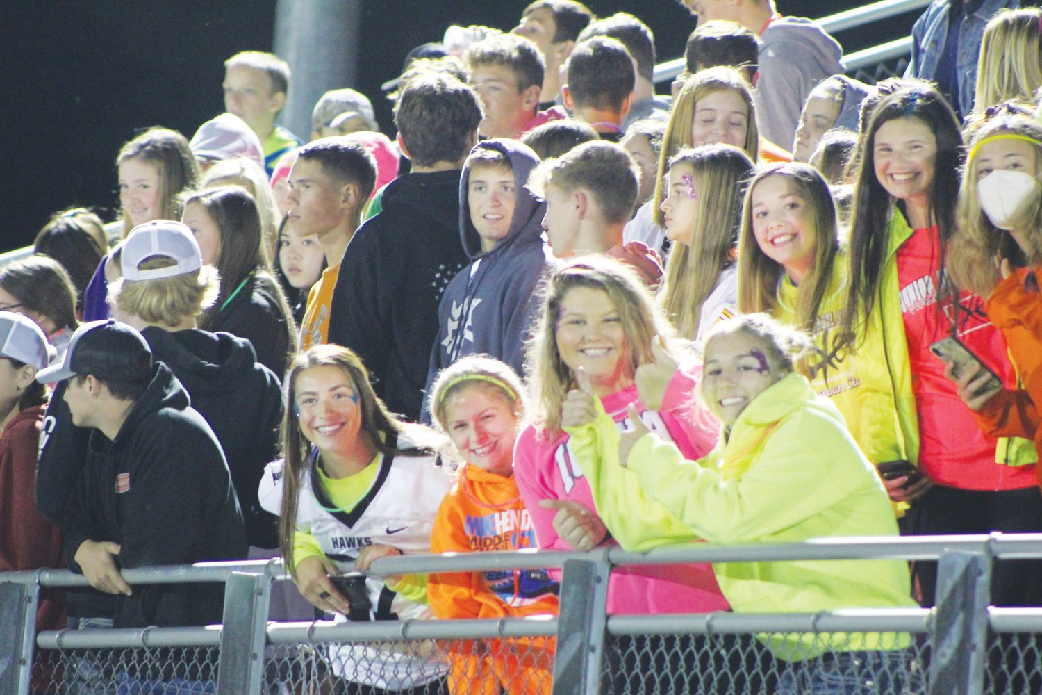Students watch from the student section at the Mid-Prairie's football game against EBF on Sept. 18. The Mid-Prairie school board decided on Oct. 12 not to impose a mask mandate for spectators at indoor or outdoor athletic events.