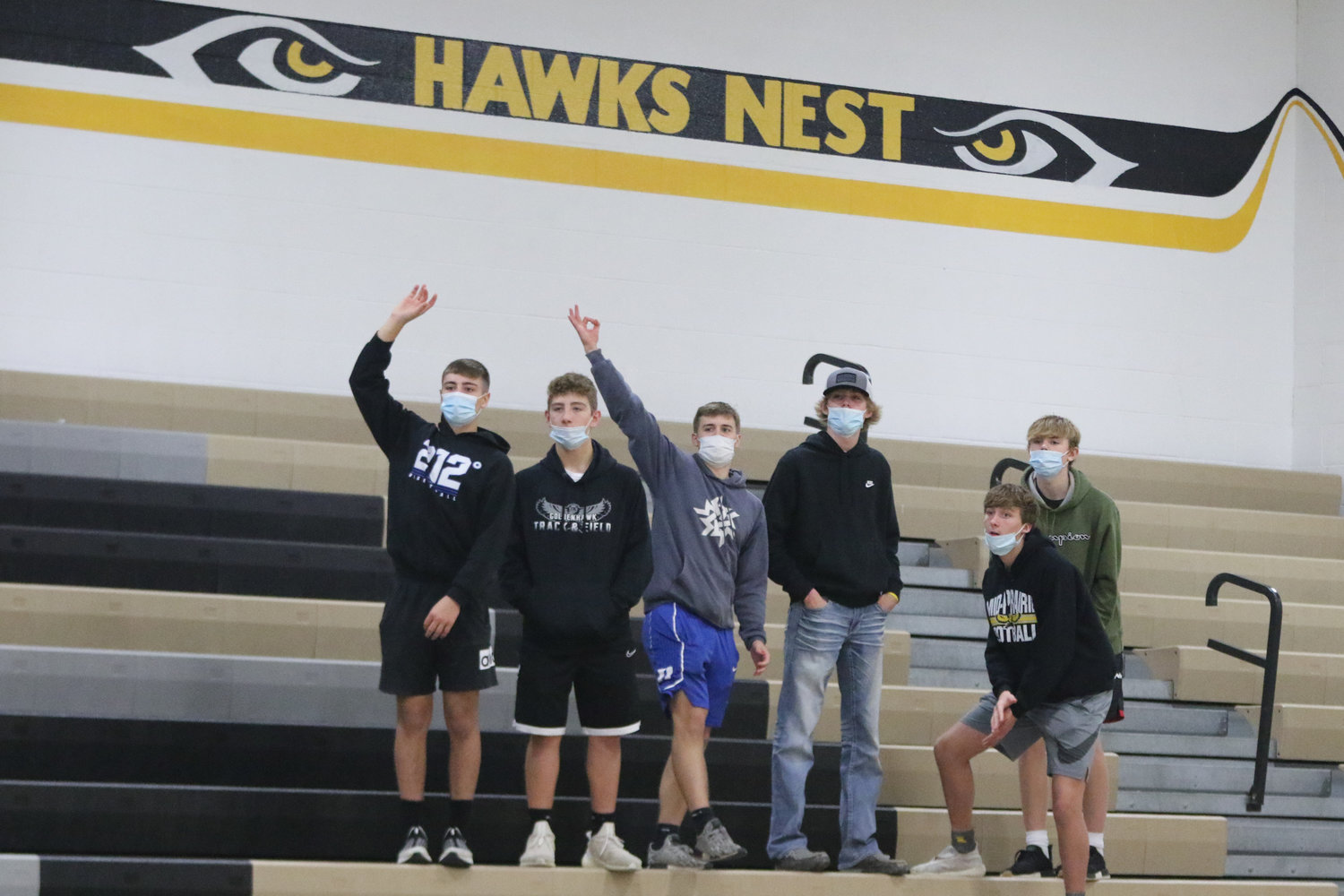 A small student section watches first half action during Mid-Prairie's scrimmage with Mediapolis in Wellman on Saturday, November 21.