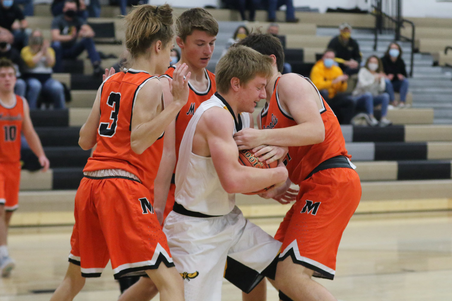 Luke Boyse is surrounded by Bulldog defenders after grabbing a rebound during the first quarter of a scrimmage with Mediapolis in Wellman on Saturday, November 21.
