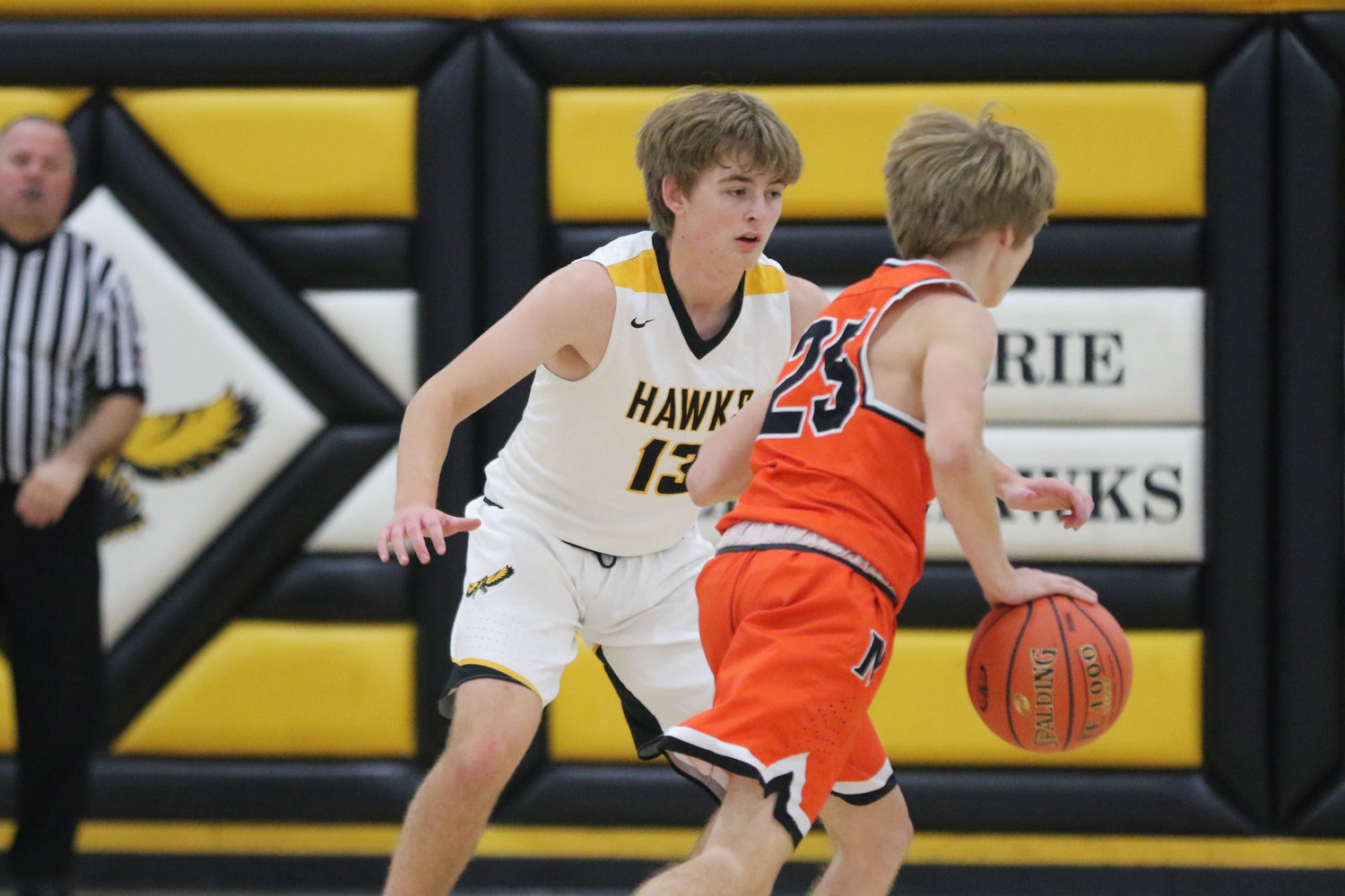 Mid-Prairie's Alex Bean (13) defends a Bulldog ball handler during the first quarter of a scrimmage with Mediapolis in Wellman on Saturday, November 21.