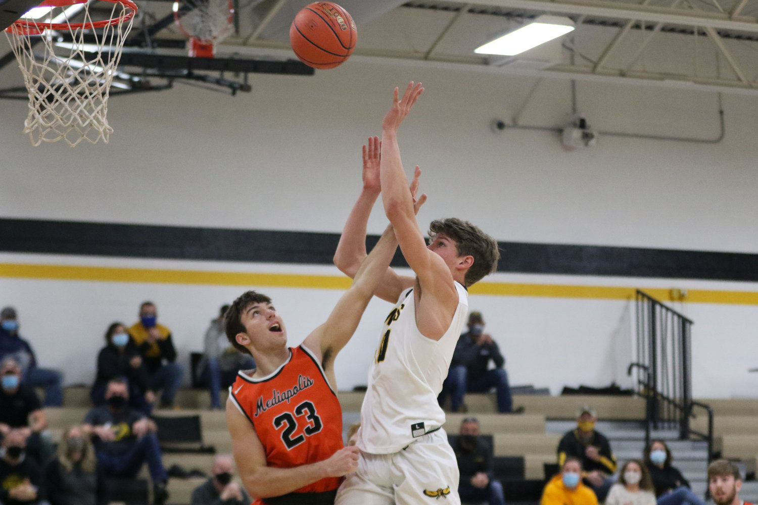 Mid-Prairie forward Carter Harmsen shoots over a Bulldog defender during the first quarter of a scrimmage with Mediapolis in Wellman on Saturday, November 21.