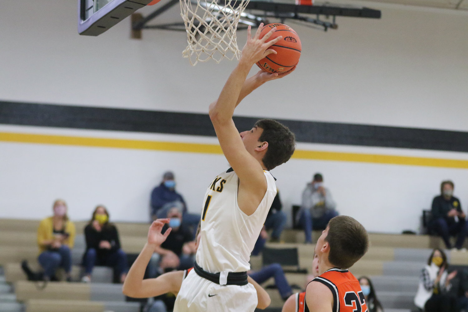 Ethan Kos puts up a shot in the paint during the first quarter of a scrimmage with Mediapolis in Wellman on Saturday, November 21.