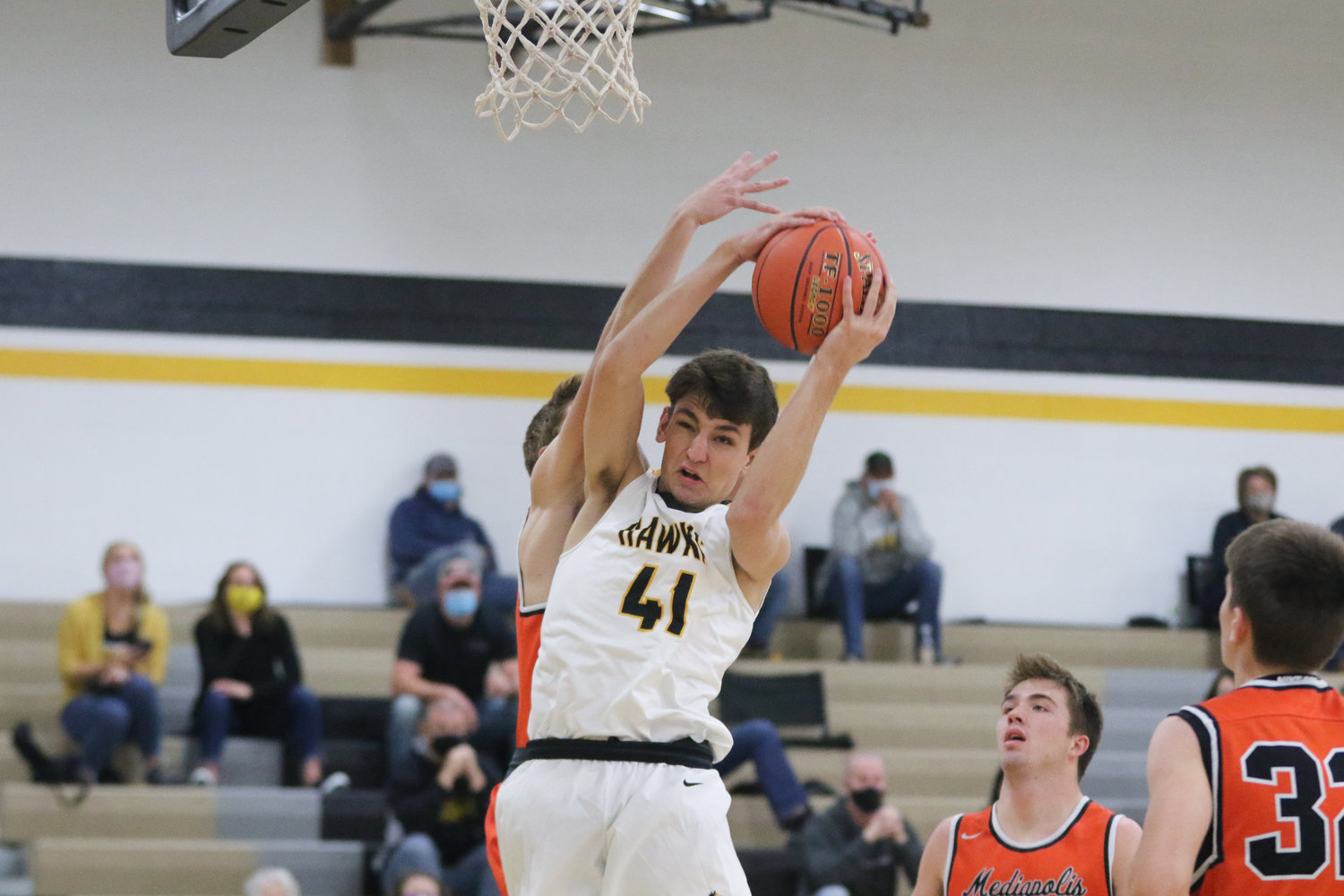 Mid-Prairie forward Ethan Kos grabs a rebound during the first quarter of a scrimmage with Mediapolis in Wellman on Saturday, November 21.