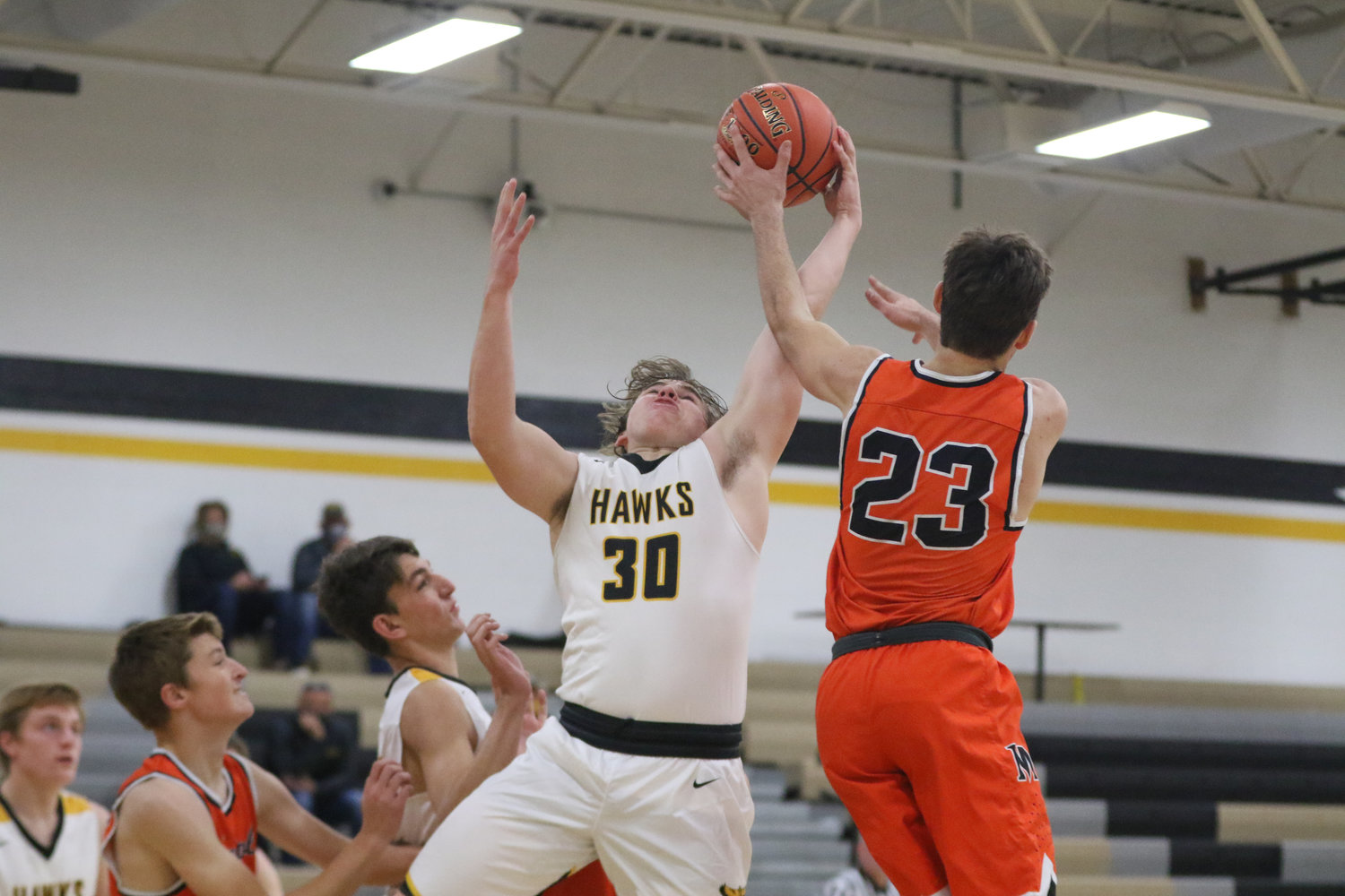 Mid-Prairie's Justice Jones fights for a rebound during the first quarter of a scrimmage with Mediapolis in Wellman on Saturday, November 21.