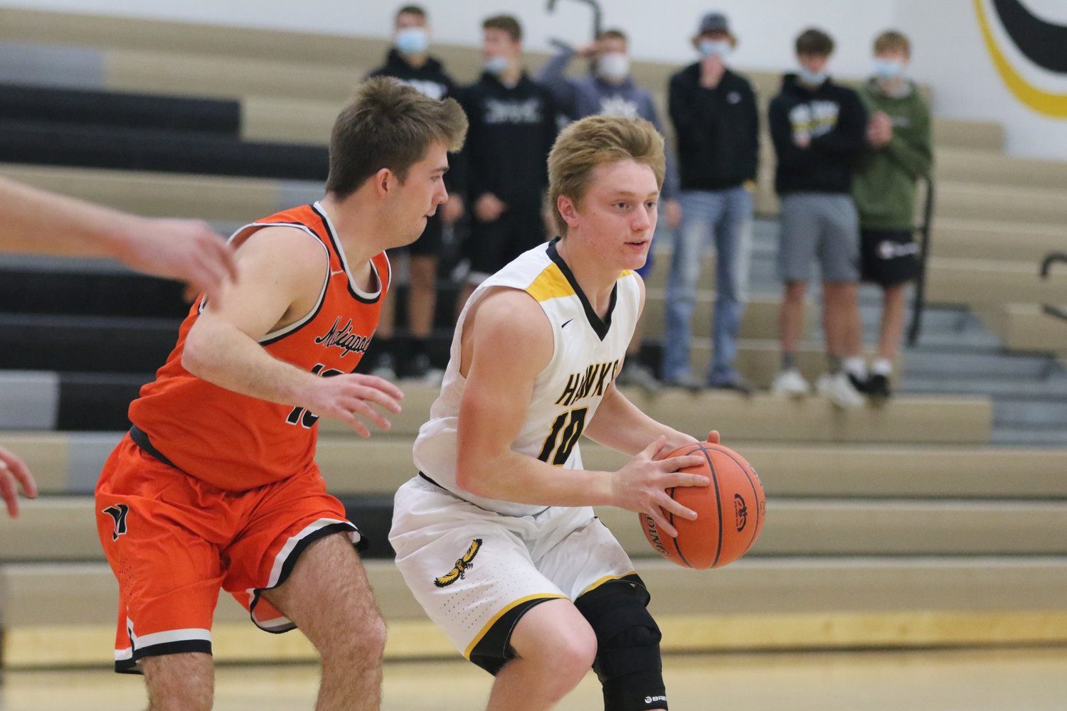 Mid-Prairie guard Luke Boyse looks for a teammate during the first quarter of a scrimmage with Mediapolis in Wellman on Saturday, November 21.