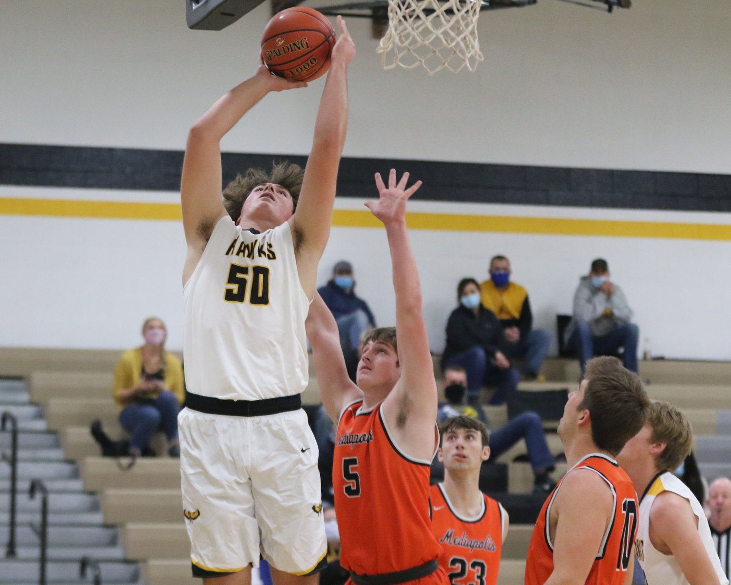 Aidan Rath puts up a shot in the paint during the first quarter of a scrimmage with Mediapolis in Wellman on Saturday, November 21.