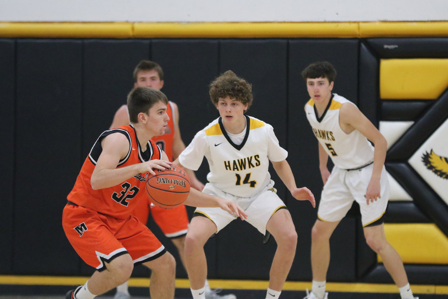 Mid-Prairie guard Jackson Pennington (14) defends Mediapolis' Ben Egan during the first quarter of a scrimmage in Wellman on Saturday, November 21.