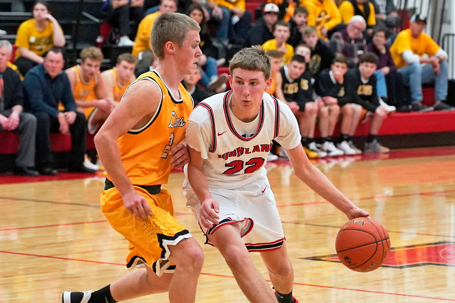 Huskie guard Mason McFarland is guarded by Tyler McCullough during a matchup between Highland and Lone Tree on January 9, 2020.