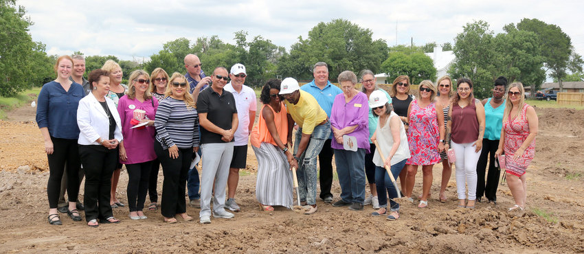 """The Sealy Chamber of Commerce helped Evlyn Court Condominiums break ground Tuesday afternoon at the site on Schmidt Road. Shoveling the dirt are developers Charlotte and Barry Lynn and real estate agent Michelle Zwicky. Pictured to the left of the Lynns in black is Joe Jimenez, the project's builder. There will be 16 two-bed, two-bath condos on the site. """"Within four months the first people can move in,"""" Zwicky said. Zanetta Knesek welcomed the Lynns on behalf of the chamber. """"This is a wonderful opportunity for our residents,"""" she said."""