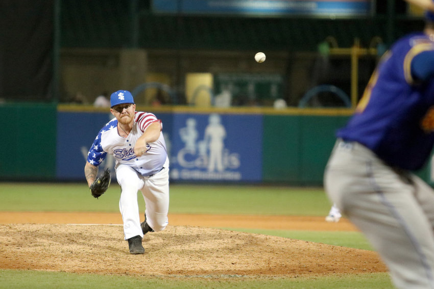 Robbie Ross Jr. pitches in relief during a recent game against the High Point Rockers at Constellation Field where he continues to get work in for a potential return to the MLB.