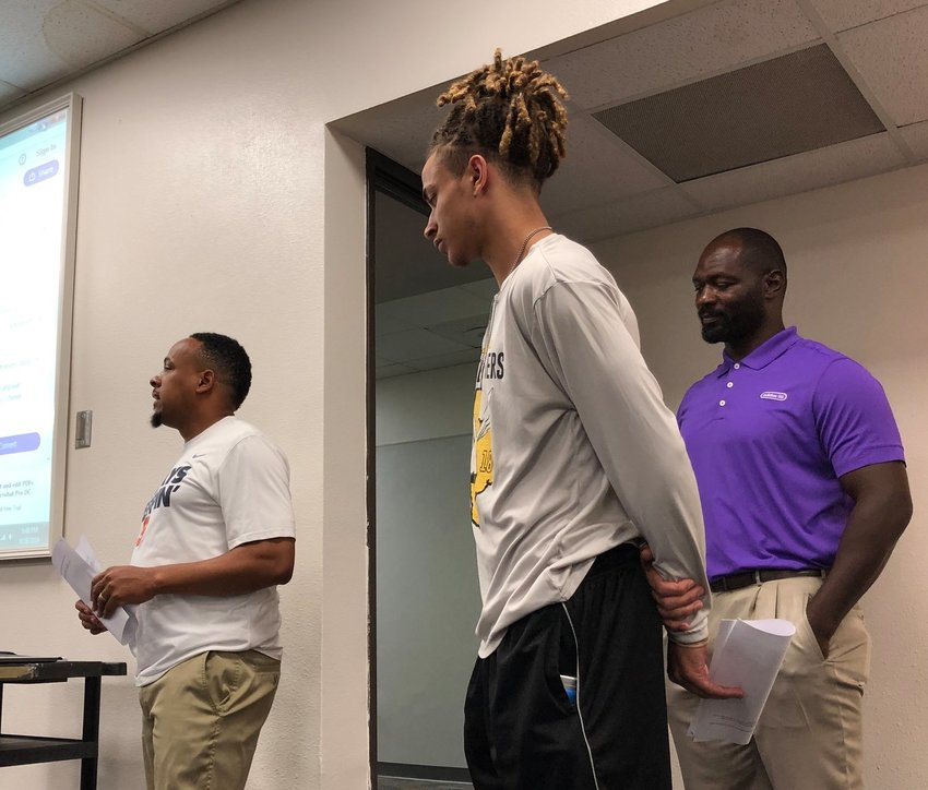 Coach Ray Dabney (left) presented the track athletes that made it all the way to the state championships to the Sealy ISD Board of Trustees at its most recent meeting last Wednesday. Ivan Bolden (middle) was one of three Tigers making it to the top level this year and was joined by boys' head track coach Giles Montgomery (right).