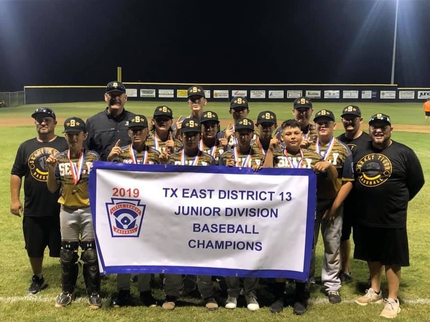 The All-Star season was once again fruitful for Greater Sealy Little League with the Junior Division team grabbing their third consecutive District 13 Championship. Pictured in the front row holding the banner are, from the left, David Kainer, Dillon Dornak, Zachary Barrientos, Juan Perez and Dylan Aguado. In the second row are Braden Tyler, Jay Aguado, Austin Browning and Rylan Reichardt. In the back row are Reid Miller, Richard Hahn and Ray Ellis. The team is coached by Steve Aguado and Bradley Miller.