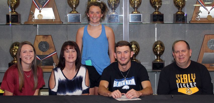 Hunter Kelley was joined by his family in confirming his commitment to Pratt Community College last Wednesday in Sealy High School's gym foyer. From left are his older sister Madeline, mother Cheri, younger sister Colette, Hunter and his father Mike.