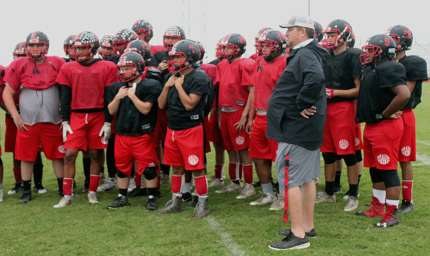 Former Brazos Cougar head football coach Ned Barrier received Houston Texans' Coach of the Week honors in week eight of the season following a 43-14 win over Yorktown and is pictured above, joined by his team that clinched three playoff berths in his time at the school.