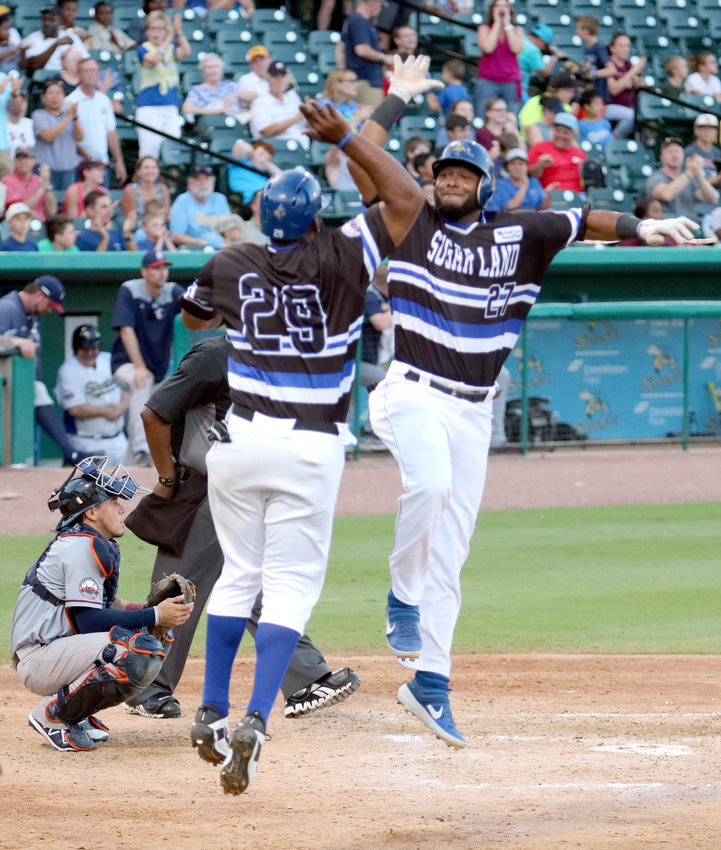 Juan Silverio (27) high-fives Dennis Phipps (29) following Silverio's grand slam in the fifth inning June 1 against the Somerset Patriots. The Sugar Land Skeeters won the game 11-6 and went 5-2 on the week at home at Constellation Field against the Patriots.