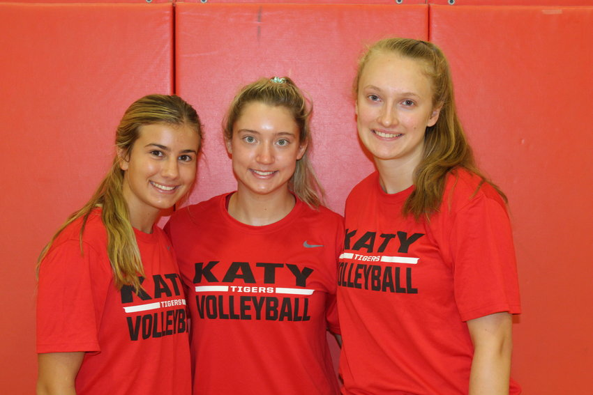 From left to right, Katy High senior Maddie Thayer, junior Hannah Hoover and sophomore Maddie Waak are the core talents of a reloading Tigers team.