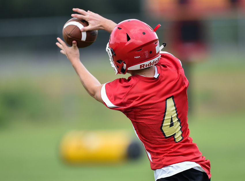 A St. John XXIII receiver makes a catch during practice August 2.