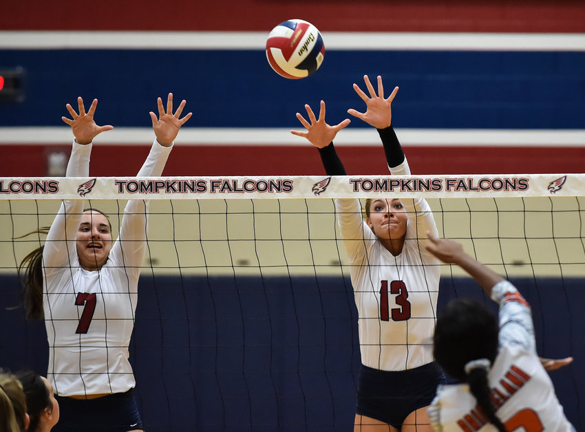 August 13, 2019: Tompkins Paris Herrman (13) and Tompkins Jacqui Reisz (7) get the block on a shot by Bridgeland's Alyssa McMorris (3) during the high school volleyball game between Tompkins and Bridgeland High School at Tompkins HS in Katy Tx.   Mark Goodman - Katy Times