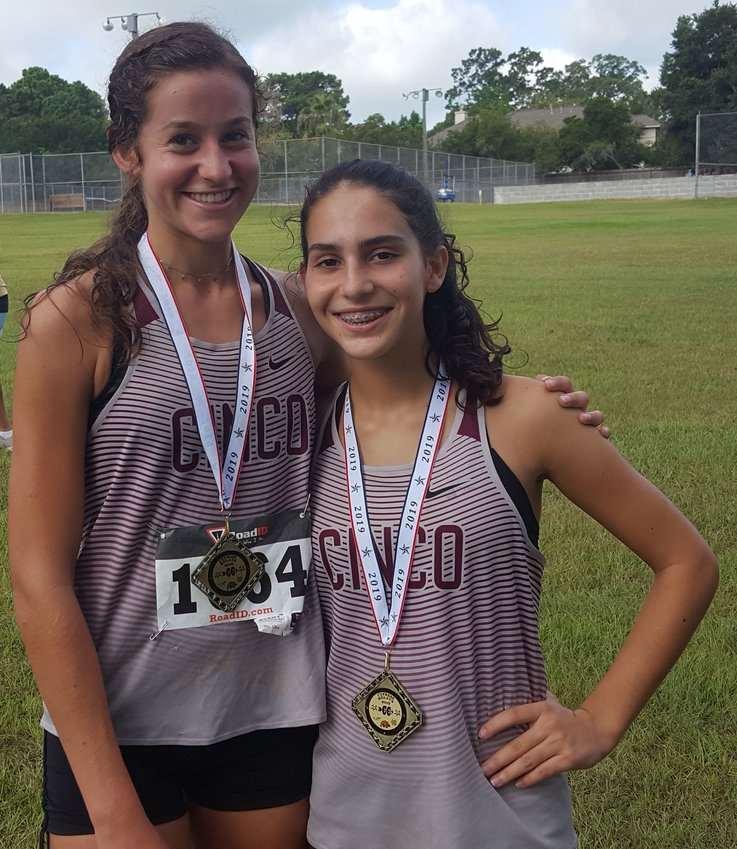 Cinco Ranch's Sophie Atkinson, left, and Natalia Corser.
