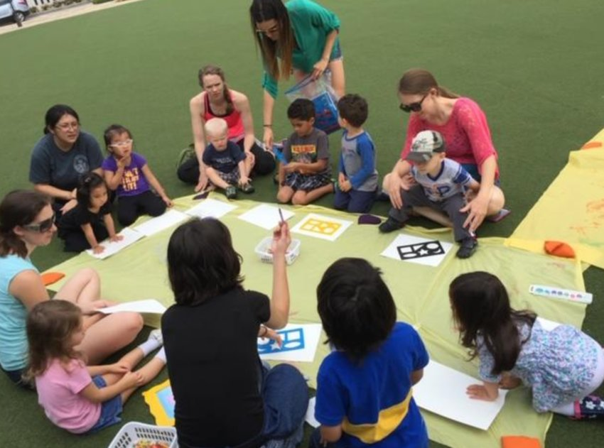 Homeschooled children gather at Central Green for a free art class.