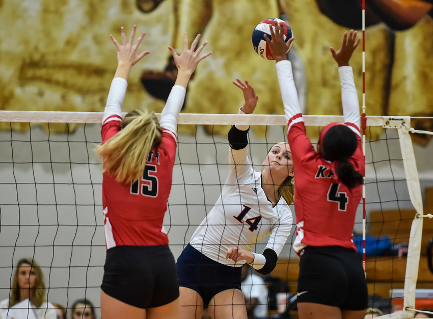 Katy Tx. Sept 24, 2019:  Seven Lakes Ally Batenhorst (14) returns the shot as Katy's Perris Key (4) goes up for the block attempt during a conference high school volleyball game between Katy and Seven Lakes at SLHS. (Photo by Mark Goodman / Katy Times)