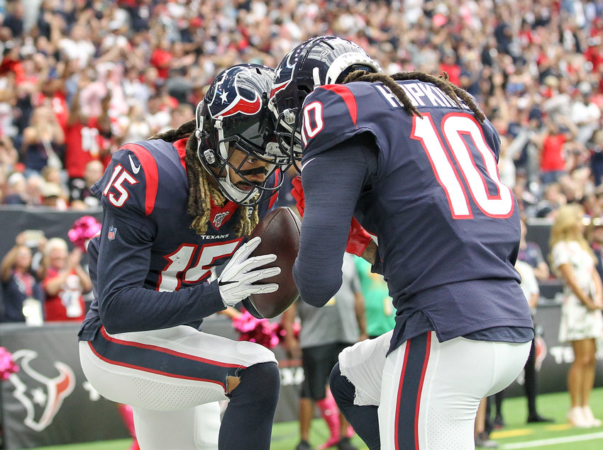 Houston Texans wide receiver Will Fuller (15) and wide receiver DeAndre Hopkins (10) celebrate in the end zone after a touchdown in the first quarter of an NFL game between the Houston Texans and the Atlanta Falcons at NRG Stadium in Houston, Texas, on Oct. 6, 2019.