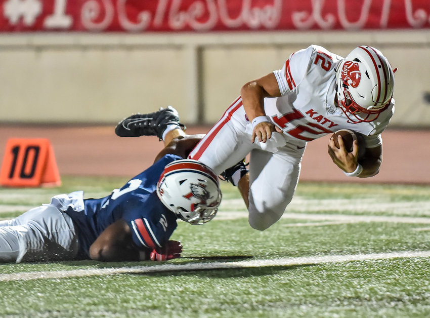 Humble, Tx. Sept 8, 2019: Katy's QB Bronson McClelland (12) dives to the end zone for the TD during a game with Atascocita at Turner Stadium. (Photo by Mark Goodman - Katy Times Sports)