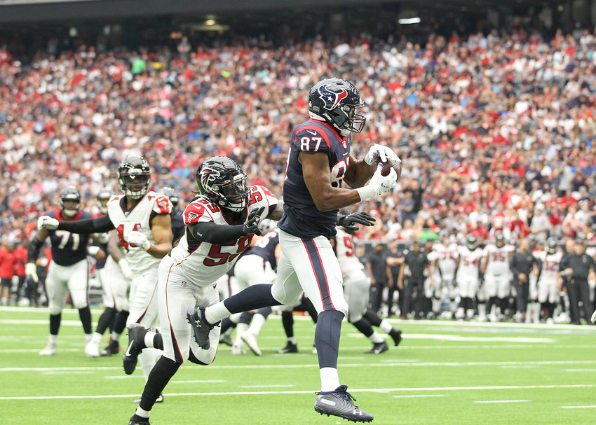 Houston Texans tight end Darren Fells (87) catches an 8-yard touchdown pass in the third quarter of an NFL game between the Houston Texans and the Atlanta Falcons at NRG Stadium in Houston, Texas, on Oct. 6, 2019.